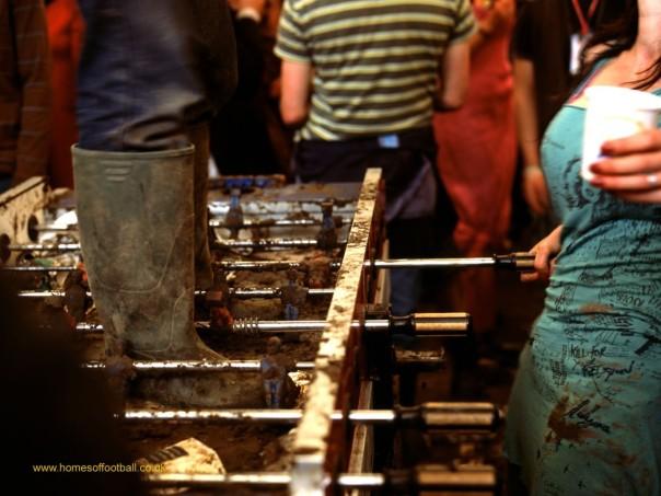 20241-Muddied-table-football-Glastonbury-FestivalEngland-year2005-by-Stuart-Roy-Clarke-1373x1030