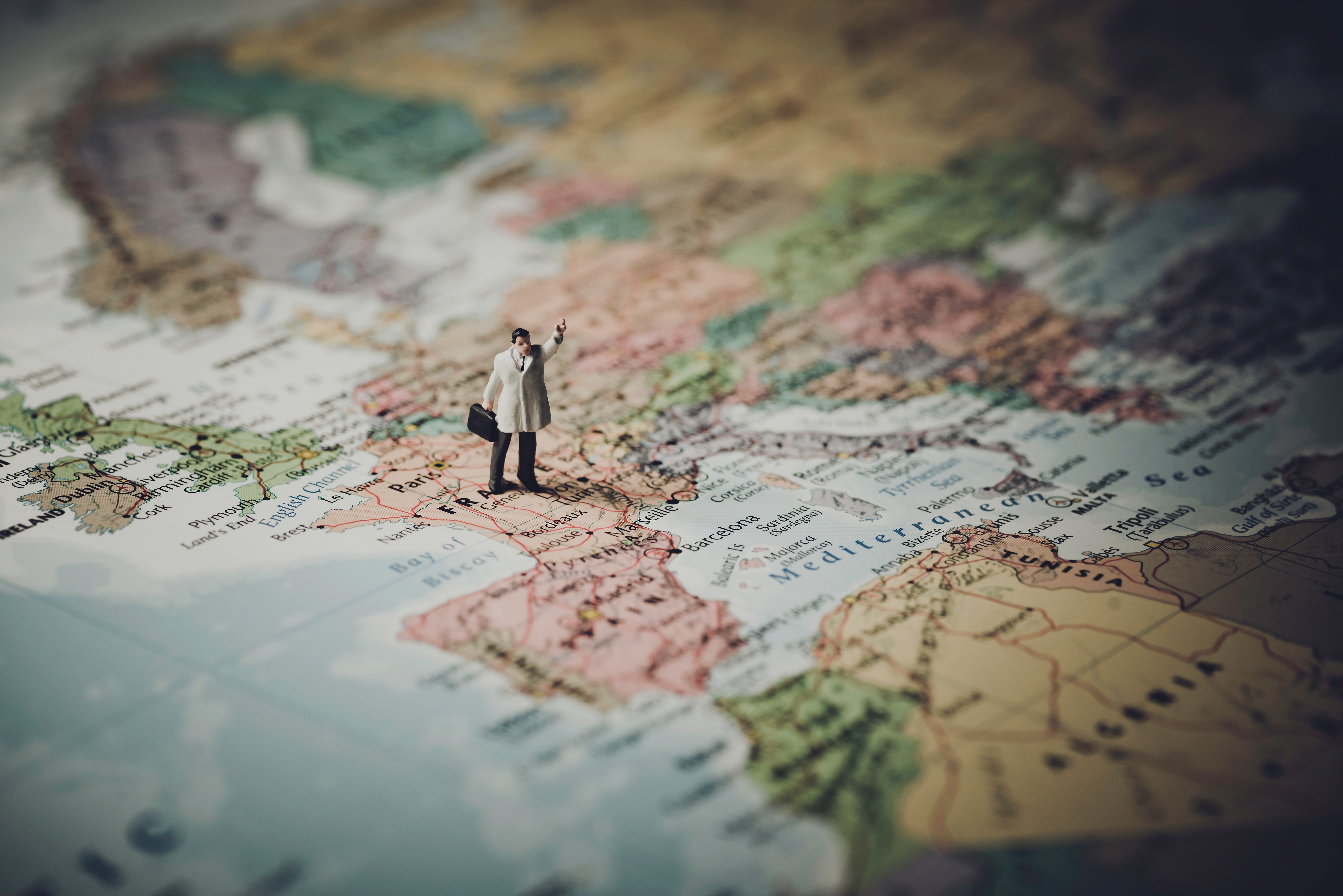 Miniature businessman on map of Europe